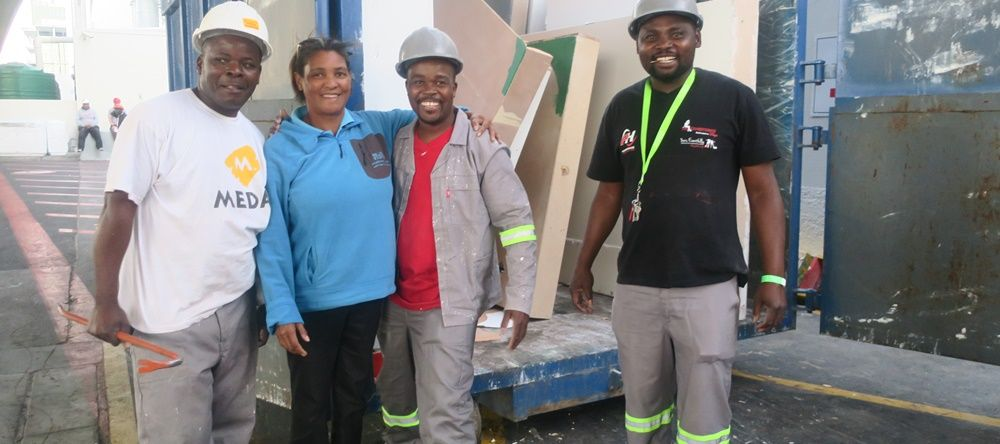 Mother's Unite accepted the wood from AfricaCom 2017 to be used in community projects